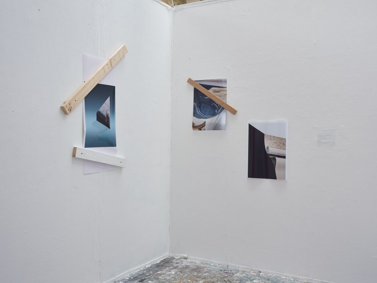 three colour photographs with block structures to secure
