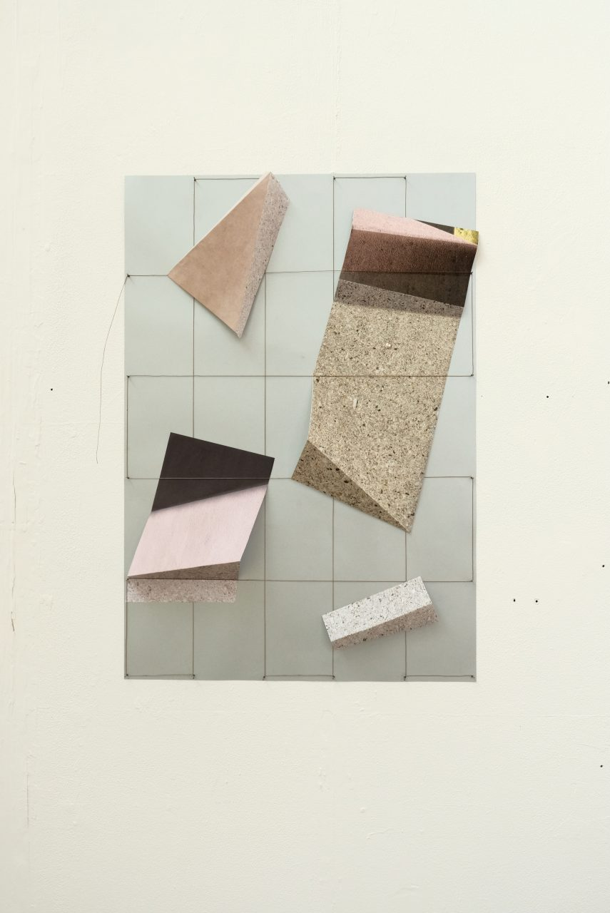 photograph grid formation with abstract folded shapes