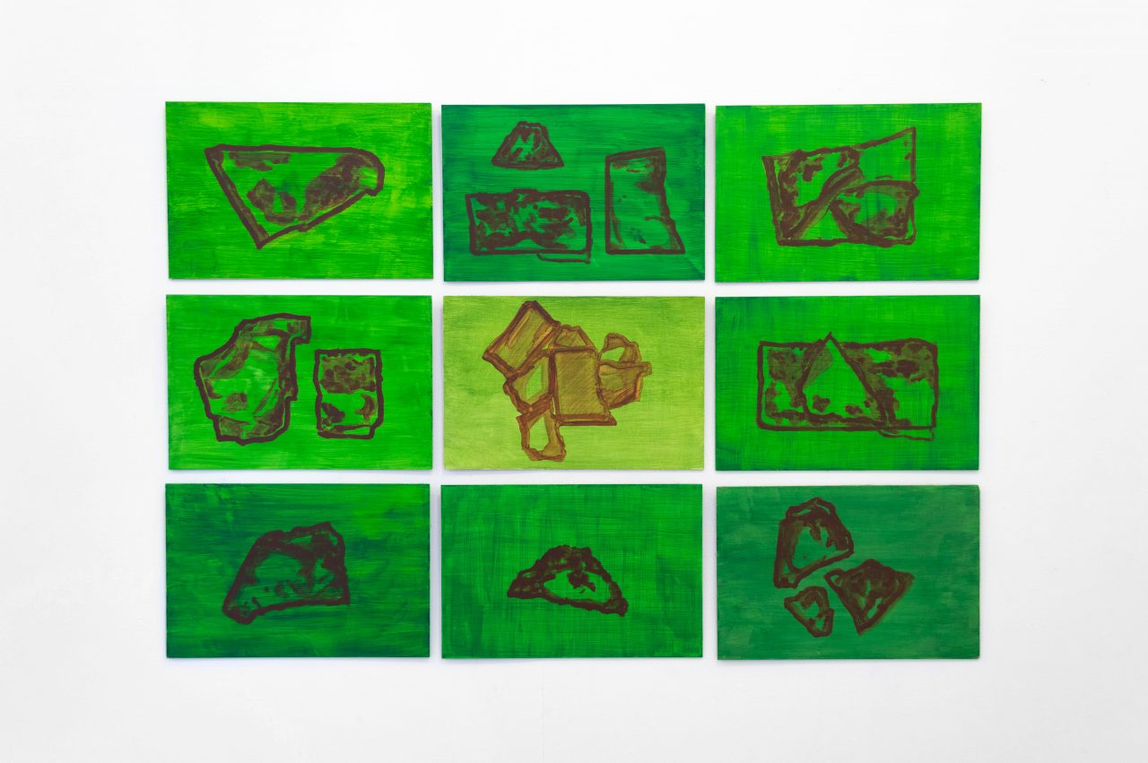 A series of 9 rectangular vivid green paintings on wooden board. Each painting uses thin fluid washes of vibrant green, with geometric patterns like rock formations painted in thin washes of brown.