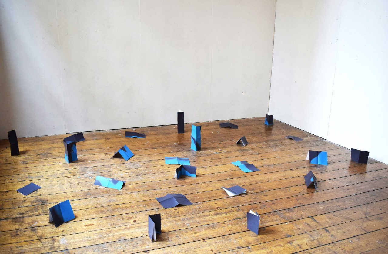 I in Black, in Blue Installation into space of an A6 book made up of 24 folded A4 inkjet printed pages, unbound