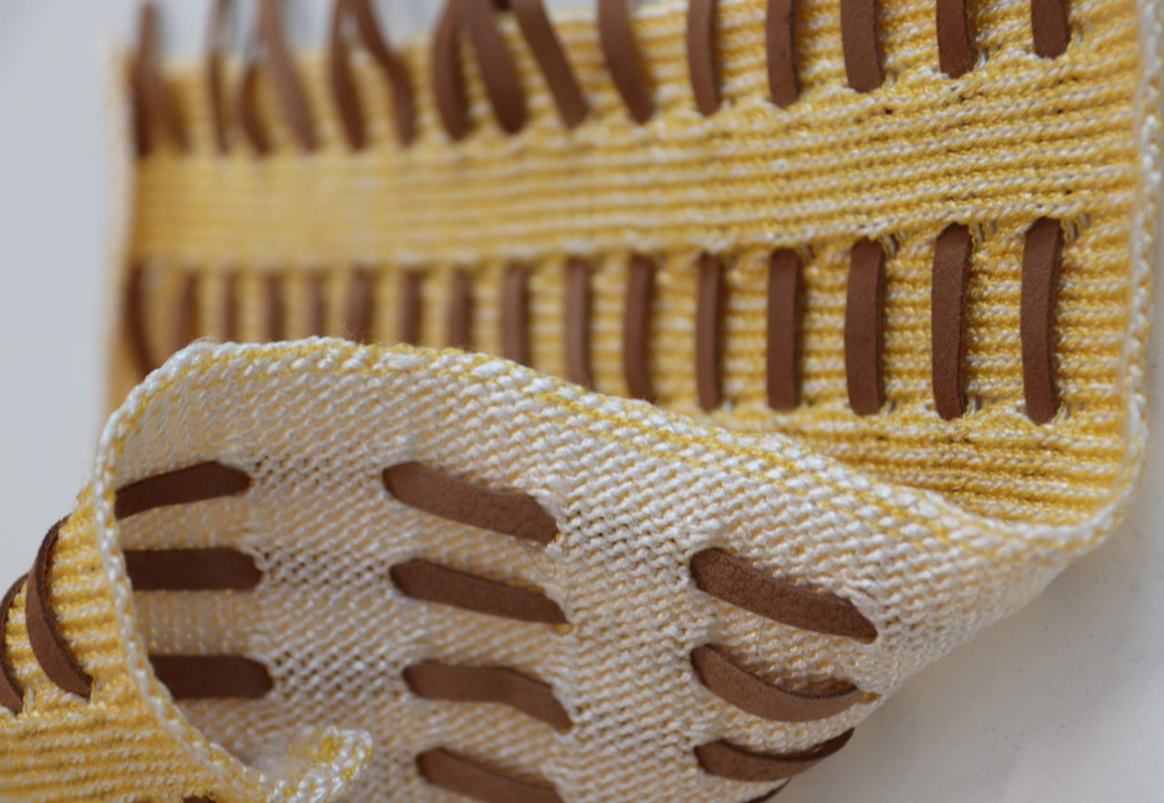 Knitted fabric with leather stitch