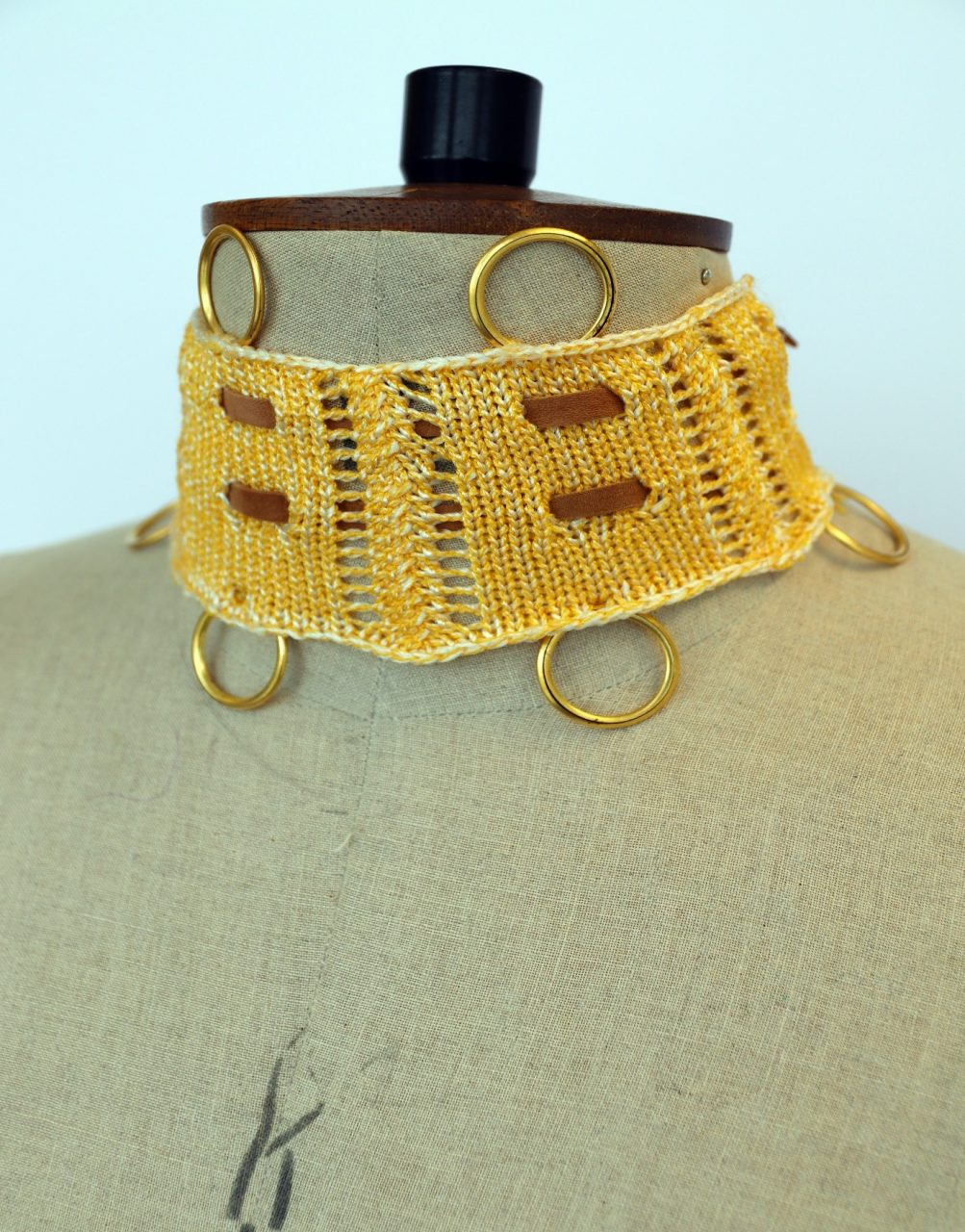 knitted choker with leather inserts and hoops