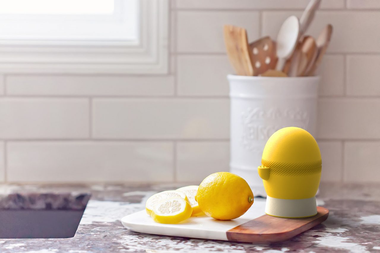Lemi in a kitchen on chopping board next to lemons.
